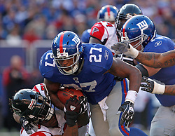Nov 22, 2009; East Rutherford, NJ, USA; New York Giants running back Brandon Jacobs (27) runs with the ball during the first half of their game against the Atlanta Falcons at Giants Stadium. Mandatory Credit: Ed Mulholland