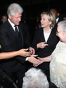 l to r: Elinor Tatum, Former President Bill Clinton, U.S.Secretary of State Hillary Clinton and Susan Tatum at The Amsterdam News 100th Anniversary Gala held at the David H. Koch Theater at Lincoln Center on November 30, 2009 in New York City. © Terrance Jennings / Retna Ltd.