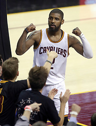 The Cleveland Cavaliers' Kyrie Irving flexes his muscles after making a shot while being fouled against the Golden State Warriors in the second quarter during Game 4 of the NBA Finals at Quicken Loans Arena in Cleveland on Friday, June 9, 2017. (Photo by Phil Masturzo/Akron Beacon Journal/TNS) *** Please Use Credit from Credit Field ***