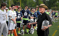 7 MAY 2009 -- CREVE COEUR, Mo. -- The Rev. Michael Marchlewski, known to generations of students at St. Louis University High School and DeSmet Jesuit High School as Father Marco, addresses lacrosse players from both schools following the the 7th annual Father Marco Cup game at DeSmet Saturday, May 8, 2011. The Rev. Marchlewski spent the first half on the DeSmet sidelines and the second half on the SLUH bench. Image © copyright 2011 Sid Hastings.