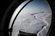 Flying with the Royal Canadian Air Forces over arctic Canada.  Nunavut landscape near Devon Island from a Squadron 440 Twin Otter during a supply flight to a Rangers patrol during Nunalivut 2012. 18 April 2012.