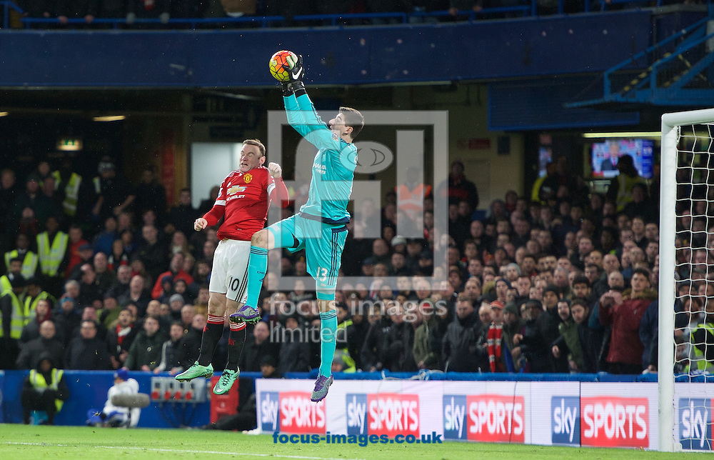 Wayne Rooney of Manchester United puts goalkeeper Thibaut Courtois of Chelsea under pressure during the Barclays Premier League match at Stamford Bridge, London<br /> Picture by Alan Stanford/Focus Images Ltd +44 7915 056117<br /> 07/02/2016