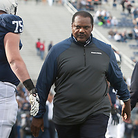 Penn State Nittany Lions defensive line coach Larry Johnson walks on the field during warm ups prior to a game against the Illinois Fighting Illini on November 2, 2013 at Beaver Stadium in University Park, Pennsylvania.
