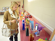 Anna Ovechkina of Levittown, Pennsylvania views some of the silent auction items during the 15th annual international dinner Saturday October 17, 2015 at St. Elizabeth Ann Seton in Bensalem, Pennsylvania.  (Photo by William Thomas Cain)