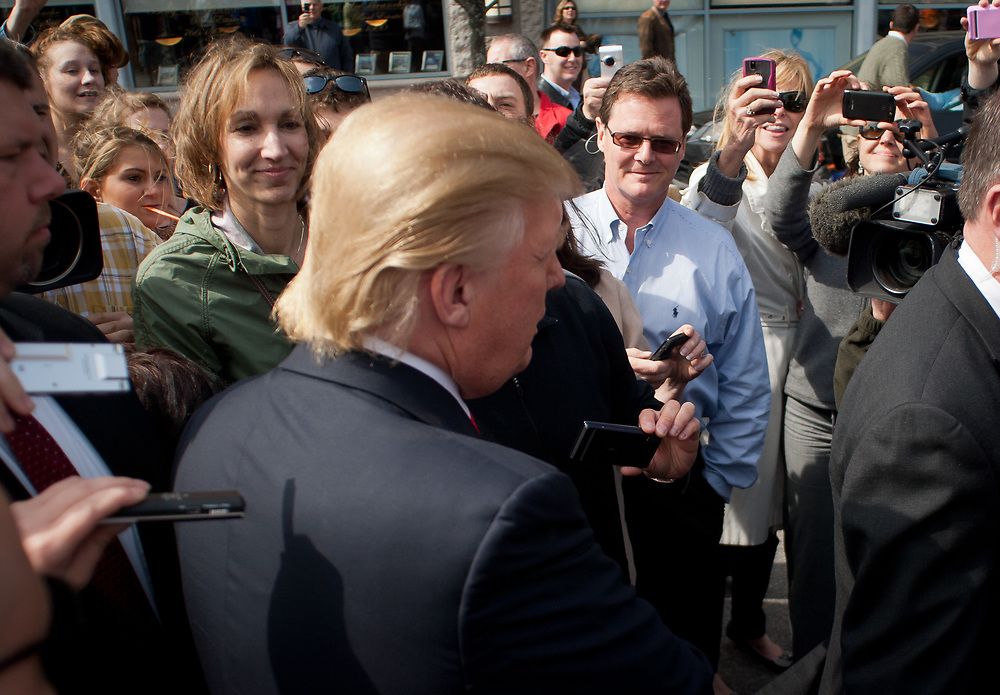 Trump supporters try to catch a glimpse of Trump as he walks around Portsmouth. Real Estate Mogul, TV Star and Presidential hopeful Donald Trump makes a visit to Portsmouth, NH for meetings and a meet and greet as he walks around Downtown Portsmouth.