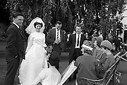 "05/09/1962<br /> 09/05/1962<br /> 05 September 1962<br /> Wedding of Fergus Keogh of ""Eagleville"", Strandville Avenue, Clontarf, Dublin to Miss Miriam Caffrey, Church Avenue, Drumcondra Dublin at the Church of the Visitation of the BVM, Fairview with reception at St. Lawrence Hotel, Howth. Mr. keogh was full-back for Bective Rangers at the time. Bride and guests in the grounds of the hotel."