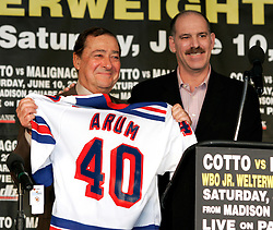 Promoter Bob Arum (l) receives a NY Rangers jersey commemorating Top Rank's 40 years promoting fights from Madison Square Gardens Joel Fisher (r) at the press conference announcing the WBO Jr. Welterweight Championship fight between champion Miguel Cotto and Paulie Malignaggi. The fight will take place on June 10, 2006 at Madison Square Garden.