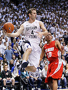 BYU guard Jackson Emery (4) looks for an open teammate as New Mexico guard Kendall Williams (10) defends during the first half of an NCAA college basketball game in Provo, Utah, Wednesday, March. 2, 2011. (AP Photo/Colin E Braley)