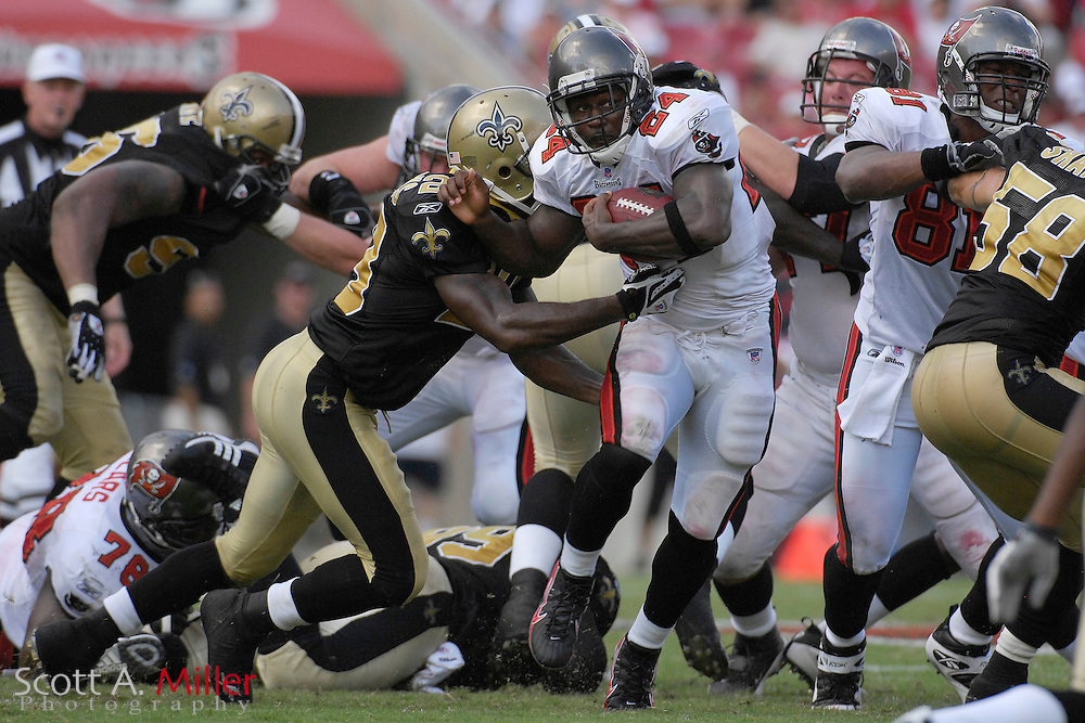 Sep 16, 2007; Tampa, FL, USA; Tampa Bay Buccaneers running back (24) Carnell Williams fights for yardage during the second half of the Bucs 31-14 win over the New Orleans Saints at Raymond James Stadium. Mandatory Credit: Scott A. Miller-US PRESSWIRE..©2007 Scott A. Miller