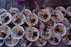June 16, 2017 - Yogyakarta, Indonesia - Indonesian Muslims prepare porridge for break fasting at Sabilurrosyad Mosque, Yogyakarta, Indonesia on June 16, 2017. This place has a tradition to break the fast by eating porridge. During the month of Ramadan, Sabilurrosyad mosque provide food menu porridge made from rice and coconut milk for break fasting. (Credit Image: © Nugroho Hadi Santoso/NurPhoto via ZUMA Press)