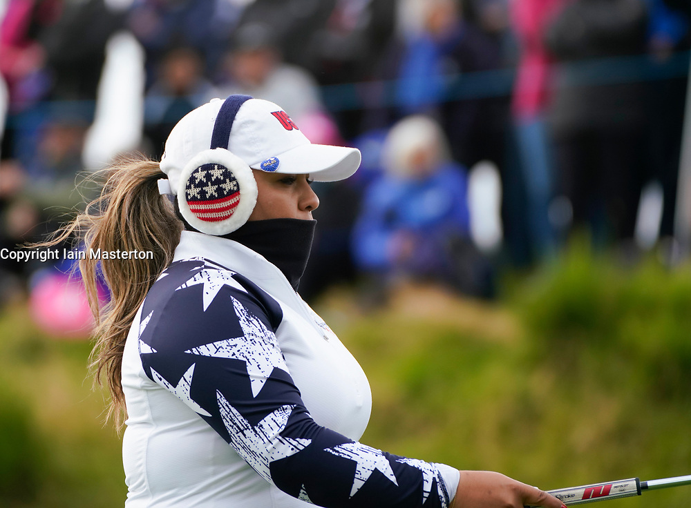 Auchterarder, Scotland, UK. 14 September 2019. Saturday morning Foresomes matches  at 2019 Solheim Cup on Centenary Course at Gleneagles. Pictured; Lizette Salas of Team USA suffering from cold weather and wearing hat, muffs and face scarf.Iain Masterton/Alamy Live News