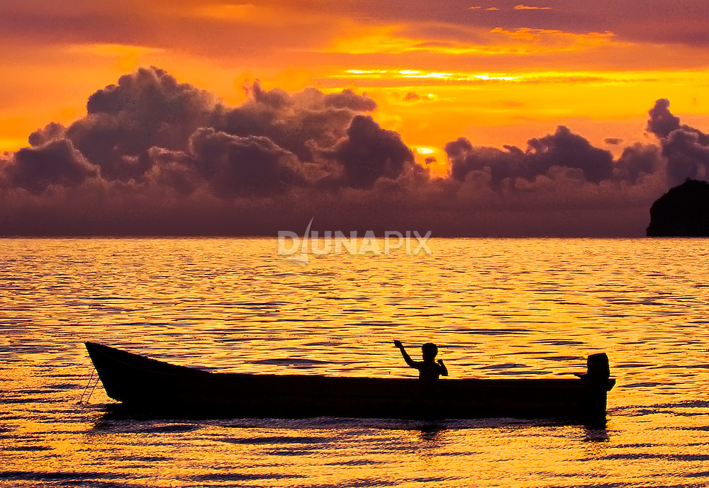 A traditional fisher hunts for dinner in Iris Strait, near Kaimana, Papua.