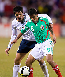United States forward Brian Ching (11) defends Mexico midfielder Pavel Pardo (8).  The United States men's soccer team defeated the Mexican national team 2-0 in CONCACAF final group qualifying for the 2010 World Cup at Columbus Crew Stadium in Columbus, Ohio on February 11, 2009.