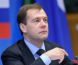 "Dmitry Medvedev, Russia's president, pauses during the EU-Russia summit at the European Union council headquarters in Brussels, Belgium, on Tuesday, Dec. 7, 2010. Russia will move a step closer to membership in the World Trade Organisation today when it signs an agreement with the European Union settling ""key questions"" that have hampered its accession bid for years. (Photo © Jock Fistick).."