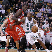 06 March 2012: Boston Celtics shooting guard Ray Allen (20) drives past Houston Rockets center Samuel Dalembert (21) during the Boston Celtics 97-92 (OT) victory over the Houston Rockets at the TD Garden, Boston, Massachusetts, USA.