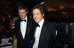 Left to right, ZAC GOLDSMITH and HUGH GRANT at the British Red Cross London Ball held at The Room by The River, 99 Upper Ground, London SE1 on 16th November 2006.<br />