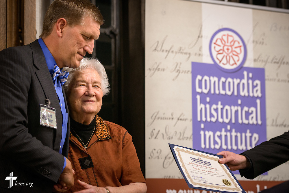 "Jeannelle Hintze receives an award from LCMS Foundation President David Fiedler on behalf of Otto Hintze, Jr., posthumously, for his book ""From Ghosts to God in Enga Land: Planting His Church Among the Enga People of Central Papua New Guinea,"" during the ""Trumpeting the Treasures"" Concordia Historical Institute 42nd annual awards banquet on Thursday, Nov. 10, 2016, at Concordia Seminary, St. Louis. LCMS Communications/Erik M. Lunsford"