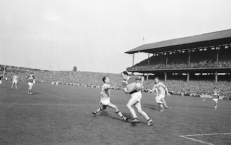 GAA All Ireland Senior Football Final Kerry v Roscommon 23rd September 1962 Croke park..C. Grogan (Roscommon) fails to stop this clearance by N.Sheehy (Kerry) on right ..23.9.1962  23rd September 1962..All Ireland SFC - Final.Kerry 1-12 | Roscommon 1-6.Time: Unknown, Venue: Croke Park.Referee: E. Moules (Wicklow).Captain: S.g Sheehy..Attendance: 75,771