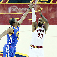 07 June 2017: Cleveland Cavaliers forward LeBron James (23) takes a jump shot over Golden State Warriors forward Kevin Durant (35) during the Golden State Warriors 118-113 victory over the Cleveland Cavaliers, in game 3 of the 2017 NBA Finals, at  the Quicken Loans Arena, Cleveland, Ohio, USA.