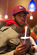 South Orange - Feb 26:  Marchers observe a moment of silence during Vigil for Trayvon Martin and All Victims of Racial Violence at Inkosi Cafe Feb 26, 2017 in South Orange, New Jersey (Photo by Matt Peyton for Village Green)