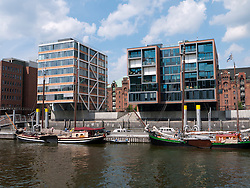 Modern apartment buildings constructed at Sandtorhafen in new Hafencity property development in Hamburg Germany