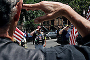 Members of the Patriot Guard Riders standing in front of the Bedsford Central Presbyterian church, while awaiting the passage of LCpl. Nicholas J. Whyteís coffin, in Brooklyn, New York, NY., on Friday, June 30, 2006. LCpl. Nicholas J. Whyte, a 21-year-old American serviceman died  on June 21, 2006, while conducting combat operations in Al Anbar province, Iraq. The Patriot Guard Riders is a diverse amalgamation of riders from across the United States of America. Besides a passion for motorcycling, they all have in common an unwavering respect for those who risk their lives for the country's freedom and security. They are an American patriotic group, mainly but not only, composed by veterans from all over the United States. They work in unison, calling upon tens of different motorcycle groups, connected by an internet-based web where each of them can find out where and when a 'Mission' is called upon, and have the chance to take part. This way, the Patriot Guard Riders can cover the whole of the United States without having to ride from town to town but, by organising into different State Groups, each with its own State Captain, they are still able to maintain strictly firm guidelines, and to honour the same basic principles that moves the group from the its inception. The main aim of the Patriot Guard Riders is to attend the funeral services of fallen American servicemen, defined as 'Heroes' by the group,  as invited guests of the family. These so-called 'Missions' they undertake have two basic objectives in particular: to show their sincere respect for the US 'Fallen Heroes', their families, and their communities, and to shield the mourners from interruptions created by any group of protestors. Additionally the Patriot Guard Riders provide support to the veteran community and their families, in collaboration with the other veteran service organizations already working in the field.   **ITALY OUT**