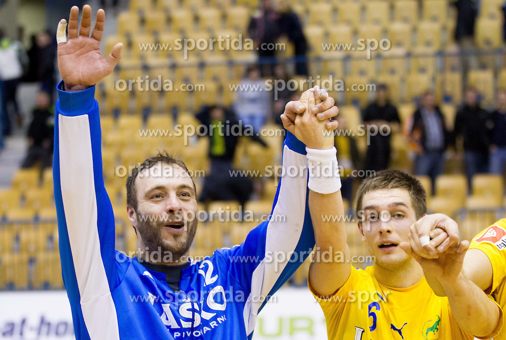 Dejan Peric and Gasper Marguc of Celje celebrate after the handball match between RK Celje Pivovarna Lasko and HC Aarhus Haandbold (DEN) in second leg match of  Last 16 of EHF Cup Winners' Cup, on February 18, 2012 in Arena Zlatorog, Celje, Slovenia. Celje defeated Aarhus 26-24 and qualified to quarterfinals. (Photo By Vid Ponikvar / Sportida.com)