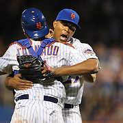 NEW YORK, NEW YORK - July 02: Pitcher Jeurys Familia #27 of the New York Mets embraces catcher Travis d'Arnaud #7 of the New York Mets after the save during the Chicago Cubs Vs New York Mets regular season MLB game at Citi Field on July 02, 2016 in New York City. (Photo by Tim Clayton/Corbis via Getty Images)