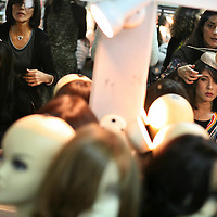 The models try on a wig behind the scenes during a fashion show for ultra orthodox women.