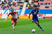 Wigan Antonee robinson runs from Barnsley Luke Thomas during the EFL Sky Bet Championship match between Wigan Athletic and Barnsley at the DW Stadium, Wigan, England on 31 August 2019.