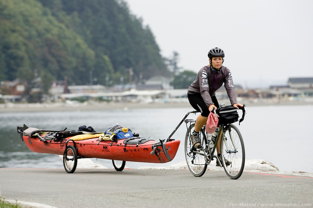 WEDNESDAY SEPTEMBER 13, 2006 - WARM BEACH, WASH.  Adventure athlete Renata Chlumska with her bicycle and kayak on the shores of Puget Sound, only one day from her return to Seattle, Wash. after circumnavigating the perimeter of the lower 48 states of the America by bike and kayak. Chlumska took 478 days to cover the approximately 11,200 miles. (Photo by Tim Matsui / timmatsui.com)