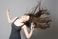 Woman with long brown hair dancing