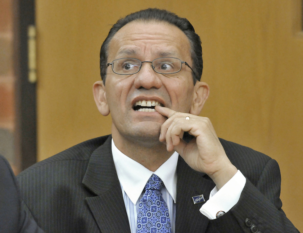 Hartford Mayor Eddie Perez bites his nail as he appears in Superior Court to request to drop corruption charges against him in Hartford, Conn.  Perez was arrested on charges he accepted a bribe from a city contractor.