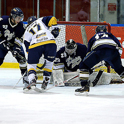 WHITBY, ON - Jan 5 : Ontario Junior Hockey League game action between the Whitby Fury and the Toronto Lakeshore Patriots. Evan Buitenhuis #29 of the Toronto Lakeshore Patriots Hockey Club makes the save.<br /> (Photo by Tim Bates / OJHL Images)