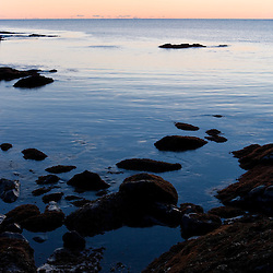 The rocky coast of Timber Point before sunrise in Biddeford, Maine.