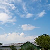 Barn under a bright blue sky.