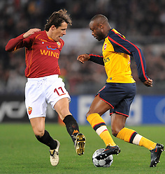 Rodrigo Taddei and William Gallas compete during the UEFA Champions League, Round of Last 16, Second Leg match between AS Roma and Arsenal at the Stadio Olimpico on March 11, 2009 in Rome, Italy.