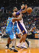 Apr 7, 2013; Phoenix, AZ, USA; Phoenix Suns forward Jared Dudley (3) loose  the ball against the New Orleans Hornets forward Darius Miller (2) in the first half at US Airways Center. The Hornets defeated the Suns 95-92. Mandatory Credit: Jennifer Stewart-USA TODAY Sports