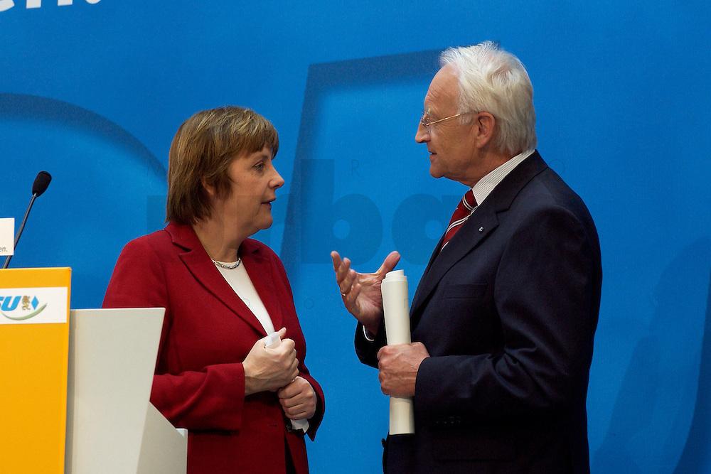 02 APR 2004, BERLIN/GERMANY:<br /> Angela Merkel (L), CDU Bundesvorsitzende, und Edmund Stoiber (R), CSU, Ministerpraesident Bayern, im Gespraech, nach einem Pressestatement zu dem vorangegangenem europapolitischen Spitzengespraech von CDU und CSU, Konrad-Adenauer-Haus<br /> IMAGE: 20040402-02-017<br /> KEYWORDS: Ministerpr&auml;sident, CDU Bundesgeschaeftsstelle, Gespr&auml;ch