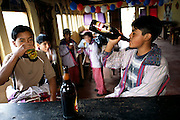 During the All Saints Day festival there seems to be no stigma attached to inebriation. The alcohol-altered state is not for adults only; a surprising number of young boys stagger around, and anyone with the money to buy a drink gets served; no questions asked. Hungry Planet: What the World Eats (p. 159). This image is featured alongside the Mendoza family of Todos Santos Cuchumatán, Guatemala, images in Hungry Planet: What the World Eats.