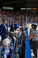 KELOWNA, BC - OCTOBER 23: Dean Brockman, head coach of the Swift Current Broncos, stands on the bench and speaks to Referee Steve Papp against the Kelowna Rockets at Prospera Place on October 23, 2018 in Kelowna, Canada. (Photo by Marissa Baecker/Getty Images) ***Local Caption***