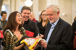 © Licensed to London News Pictures. 10/02/2018. London, UK. Labour Party Leader Jeremy Corbyn signs a tote bag for a supporter at a Labour Party conference on alternative models of ownership following the collapse of construction firm Carillion and the termination of the East Coast rail franchise. Photo credit: Rob Pinney/LNP