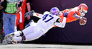 TCU's Paul Dawson pushes out Oklahoma State receiver Josh Stewart as he unsuccessfully dives for the end zone during their game in Stillwater, OK.