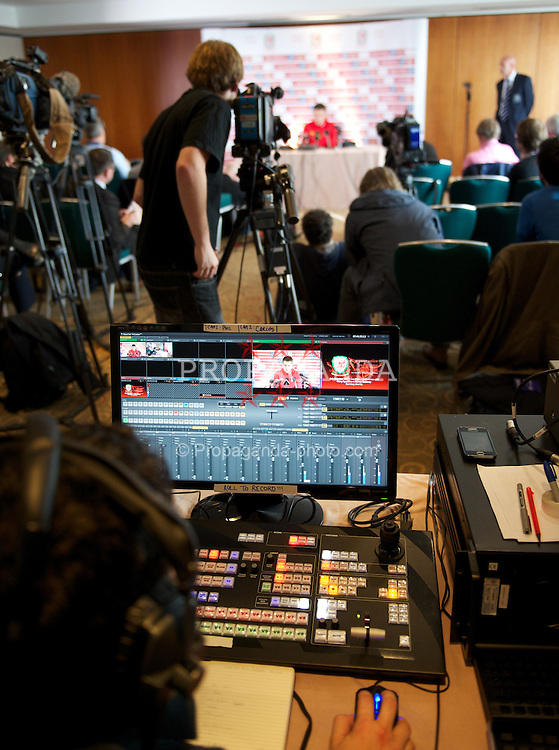 CARDIFF, WALES - Thursday, October 6, 2011: Wales' captain Aaron Ramsey is filmed for a live internet broadcast of his press conference at the St. David's Hotel ahead of the UEFA Euro 2012 Qualifying Group G match against  Switzerland. (Pic by David Rawcliffe/Propaganda)