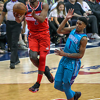 WASHINGTON, DC - MARCH 31:  Washington Wizards guard John Wall (2) goes to the basket and scores in the second half against Charlotte Hornets guard Malik Monk (1) on March 31, 2018 at the Capital One Arena in Washington, D.C.  The Washington Wizards defeated the Charlotte Hornets, 107-93 to clinch a playoff spot.  (Photo by Icon Sportswire)