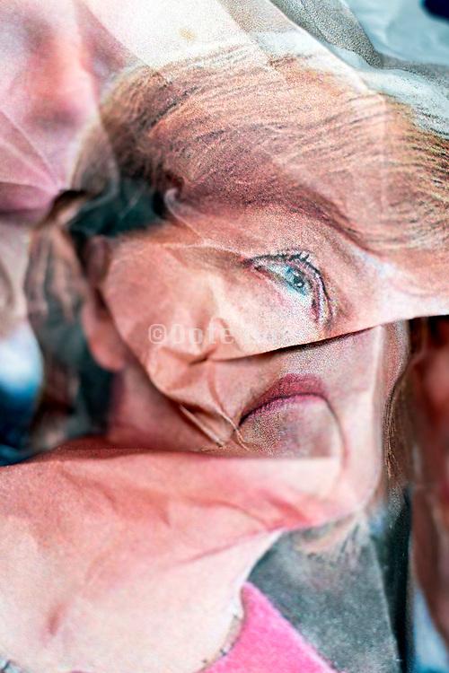 crumpled newspaper print with German Chancellor Angela Merkel