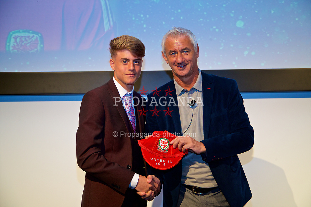 NEWPORT, WALES - Saturday, May 27, 2017: Bradley Gibbings receives his Under-16 Wales cap from Wales' Elite Performance Director Ian Rush at the Celtic Manor Resort. (Pic by David Rawcliffe/Propaganda)
