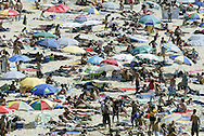 Portuguese Summer. Vacationers relax along Zambujeira beach in Alentejo.