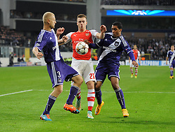 Arsenal's Calum Chambers is challenged by Anderlecht's Olivier Deschacht and Anderlecht's Youri Tielemans - Photo mandatory by-line: Dougie Allward/JMP - Mobile: 07966 386802 - 22/10/2014 - SPORT - Football - Anderlecht - Constant Vanden Stockstadion - R.S.C. Anderlecht v Arsenal - UEFA Champions League - Group D