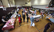 People visit the 22 booths selling items at the Indoor Winter Farmers Market at the First Street Community Center at 221 First Street NE in Mount Vernon on Saturday, April 16, 2011.